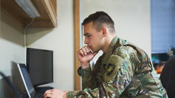 Military student working on a laptop