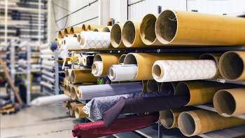 rolls of fabric in a warehouse