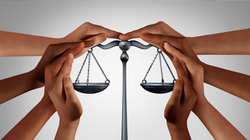 Multi ethnic hands surrounding the scales of justice