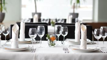 wine glasses and silverware placed on a table top