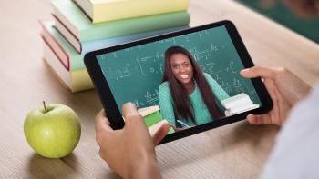 Video Conferencing With Female Teacher On Digital Tablet