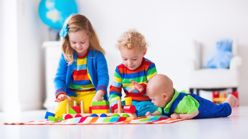 preschooler, toddler and infant playing with blocks