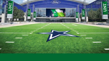 Entry to The Star in Frisco with a football field with the Dallas Cowboys star logo