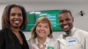 UNT faculty with two students