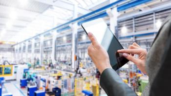 Image of a person auditing a factory using a tablet.